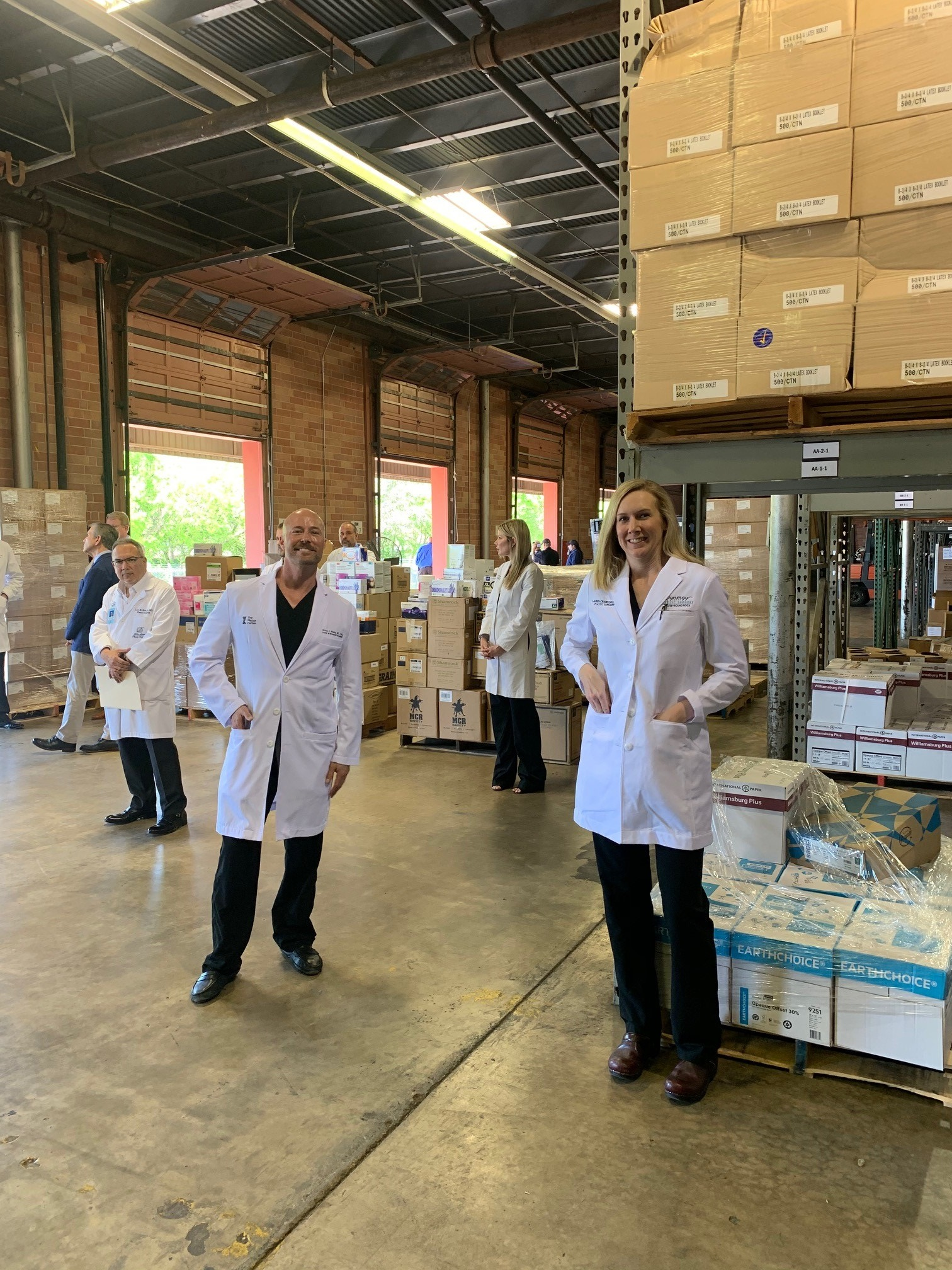 Dr. Piazza in warehouse filled with boxes