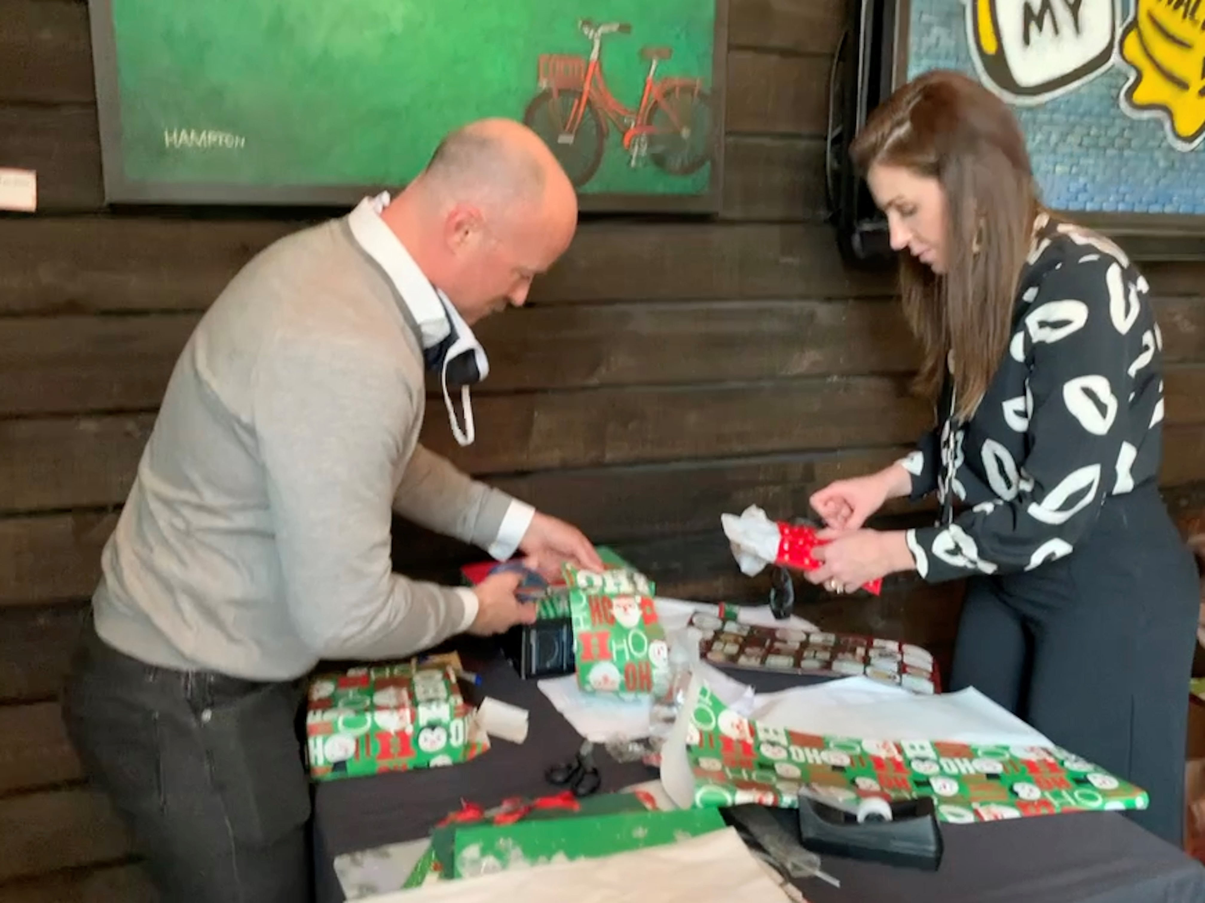 Dr. Piazza and staff wrapping presents at Christmas 2020